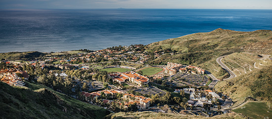 a view of the law school on pepperdine's  campus taken from the mountains overlooking the pacific ocean