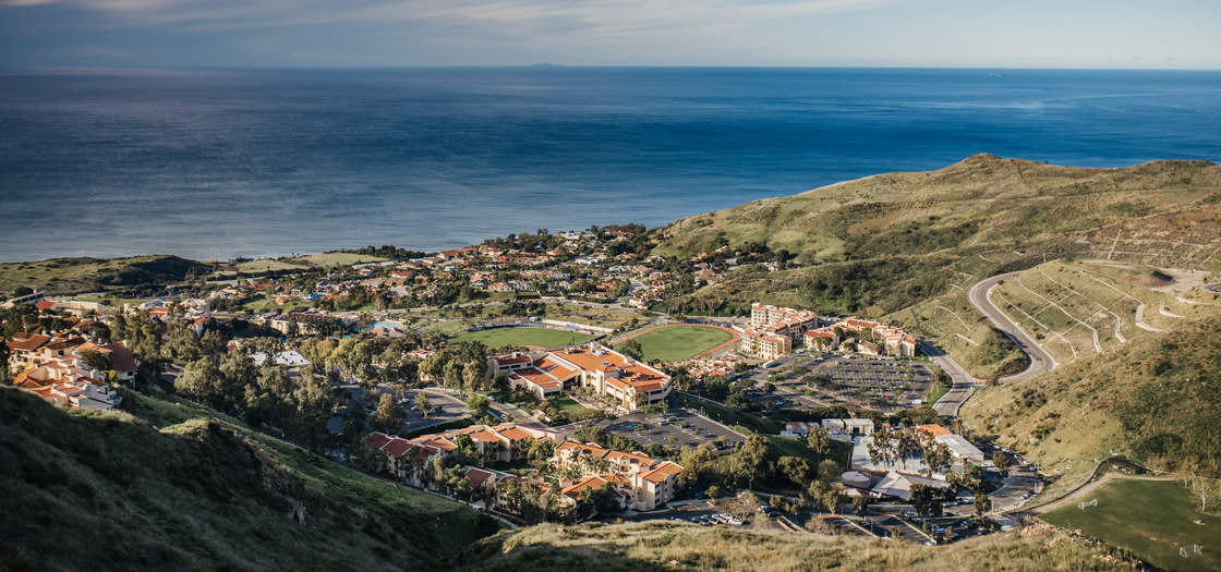 a view of the Pepperdine campus in the foreground and the ocean in the background