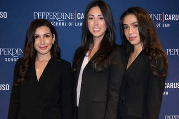 three female students dressed in black suits at a School of Law event