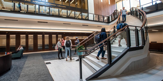 students in atrium on stairs