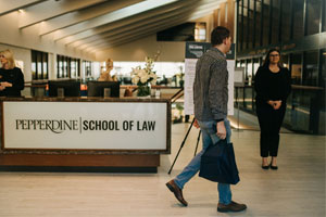 Student walking in the school of law building