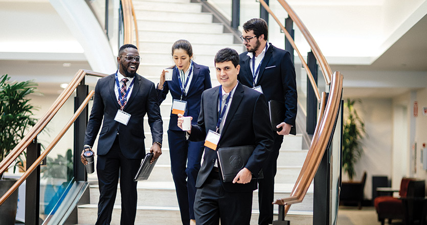 Students at trial lawyers conference walking down stairs inside