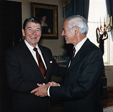 William French Smith shaking hands with President Ronald Regan