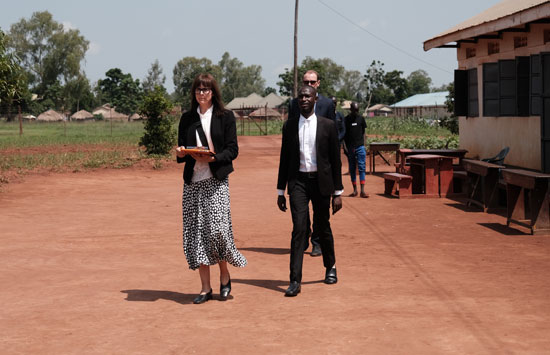 a  group of lawyers walk in a Ugandan prison
