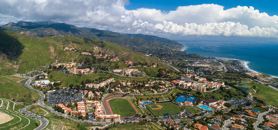 An aerial view of the entire Pepperdine campus seen from its north side with the oceean in the background