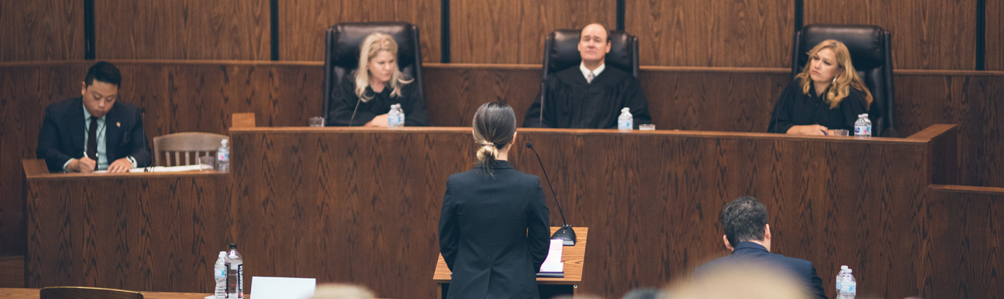 Student presents case to judges at a Pepperdine Law Moot Court competition