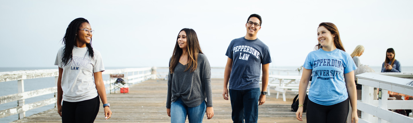 Pepperdine Law students walking together on a pier