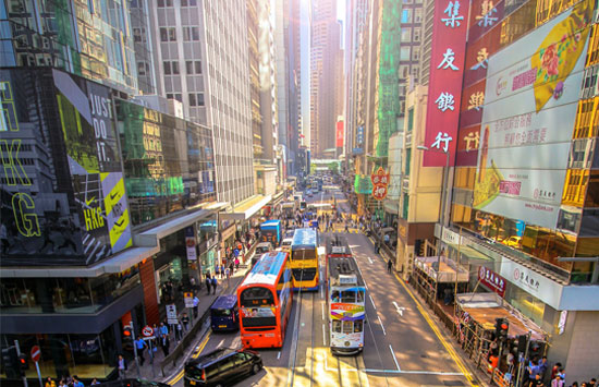 a busy and colorful street in Hong Kong