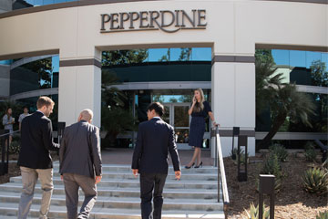 four young professionals outside of the Pepperdine Calabasas campus