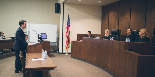 student jacob martin arguing his case at a moot court competition