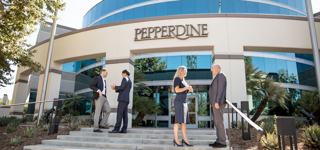 four people dressed in professional clothing stand outside of the Pepperdine University Calabasas office
