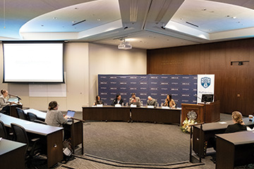 five panelists seated side by side at a pepperdine law review symposium