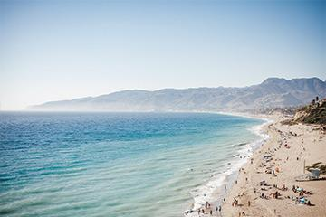 aerial view of zuma beach with blue ocean water during a sunny day