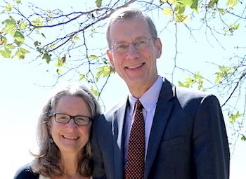 Dean Paul Caron and wife Courtney smiling under a tree