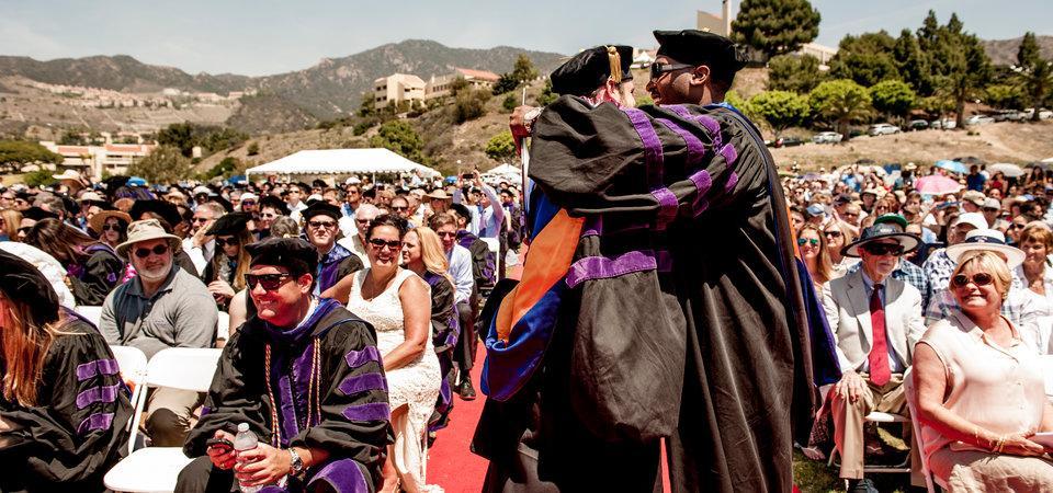 Pepperdine Law Graduates celebrating at graduation ceremony in alumni park