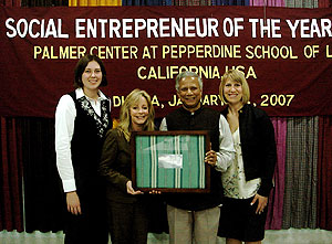 From left, Kim Retts, Prof. Janet Kerr, Dr. Yunus, and Prof. Melanie Howard gathered for a photo to celebrate Dr. Yunus as 'Social Entrepreneur of the Year'