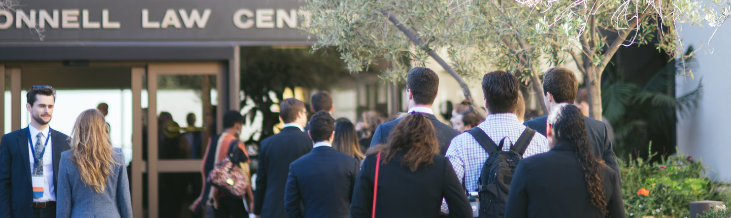 students in line outside of the Caruso School of Law in Malibu