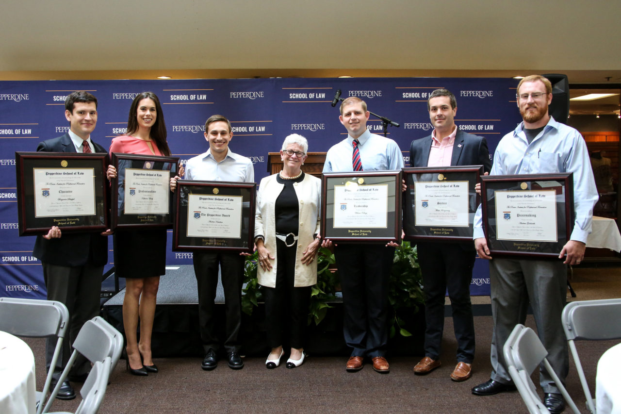 2015-2016 Parris Award Recipients pictured with Dean Deanell Tacha. From left to right: Benjamin Schuppel, Kate Handy, Andrew Kasabian, Dean Deanell Tacha, William Kellogg, Mark Montgomery, and Andrew Goldsmith