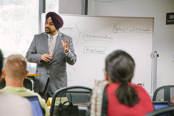 Straus Faculty Professor Singh lecturing in a class