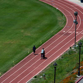 two people seen running along the track at Pepperdine