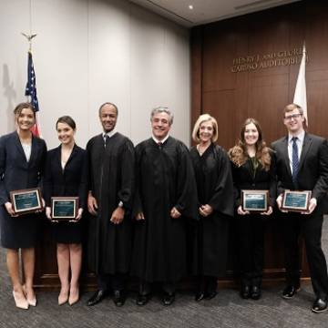 Dalsimer Moot Court Competition winners and judges in courtroom