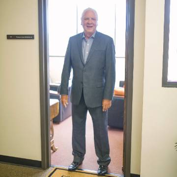 Jim McGoldrick standing in office doorway