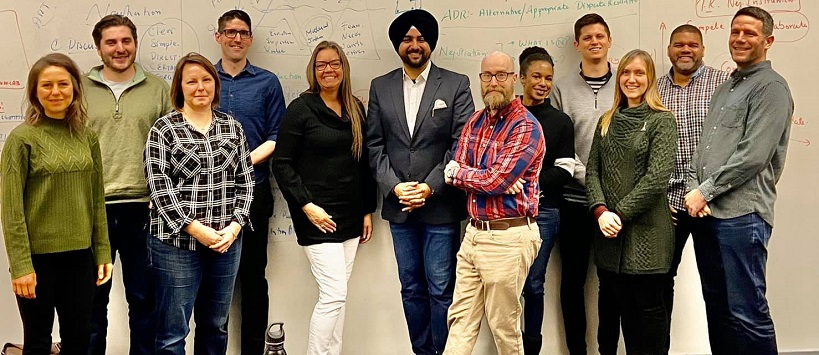Singh with Oregon students whiteboard